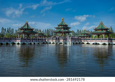 Ancient city Bangkok with Chinese temple in the lake Thailand and blue sky