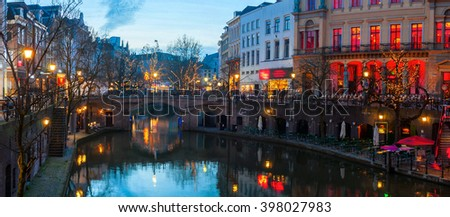 Ancient city center of Utrecht, Netherlands features many buildings from the Early Middle Ages. The Oudegracht area - a canal following the Rhine river with shops, restaurants and bars