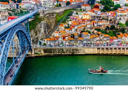 Ancient city Porto,metallic Dom Luis bridge - stock photo