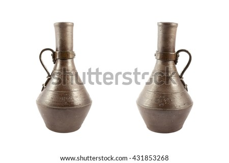 Ancient clay jug with a handle isolated on white
