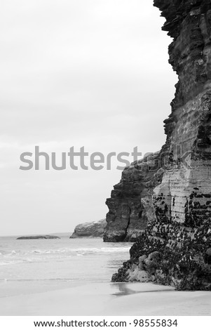 ancient cliffs on the coastal beach in ballybunion county kerry ireland in black and white - stock photo