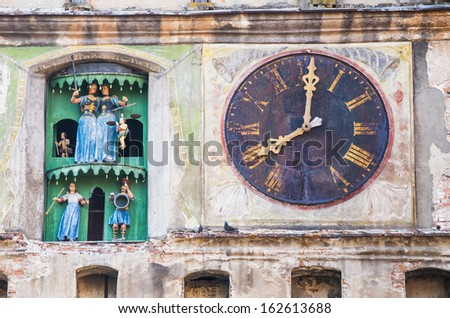 ancient clock on a medieval church - stock photo