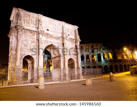 ancient Colosseum and Triumphal arch. Rome. Italy - stock photo