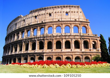 Ancient Colosseum, with flowers, Rome, Italy - stock photo