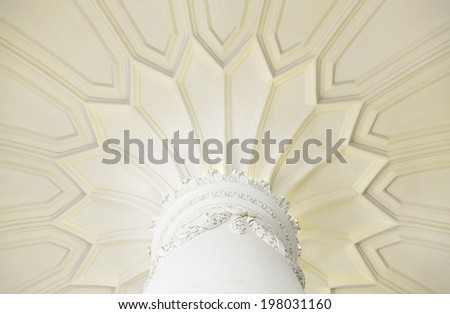 Ancient column in interior detail of a decorated column, white marble - stock photo