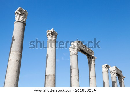 Ancient columns in a row on blue sky background, fragment of ruined roman temple in Smyrna. Izmir, Turkey - stock photo