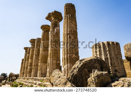 Ancient columns of Hercules Temple at Italy, Sicily, Agrigento. Greek Temples Valley. - stock photo