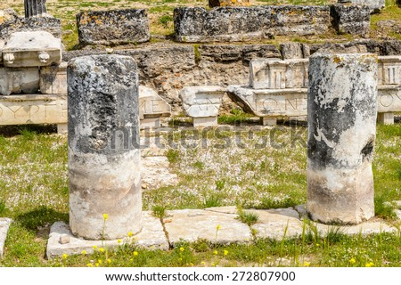 Ancient columns ruins in Hierapolis, Pamukkale, Turkey. UNESCO World Heritage - stock photo