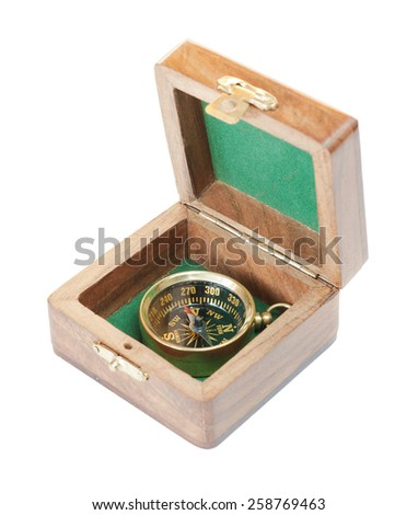 Ancient compass in a wooden case isolated on white background