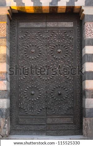 ancient copper door at old Cairo - stock photo