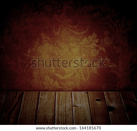 ancient dark wall with floral pattern and wood planks - stock photo