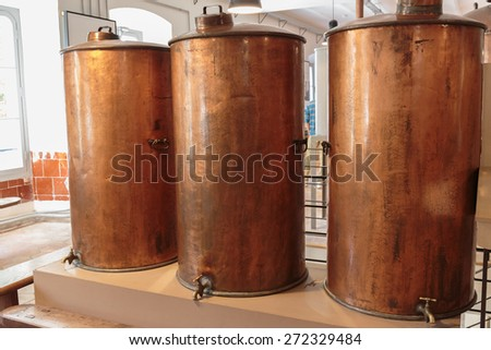 Ancient distiller for the production of perfume in Fragonard factory in Grasse, France - stock photo