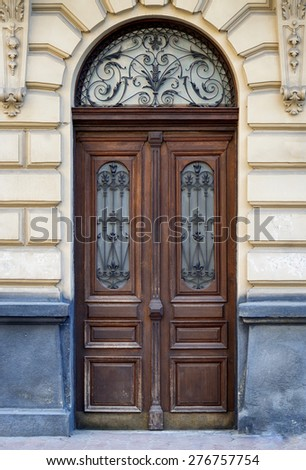 Ancient door in old stone castle wall. - stock photo