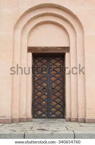 Ancient door in the Christian church. Architecture - stock photo
