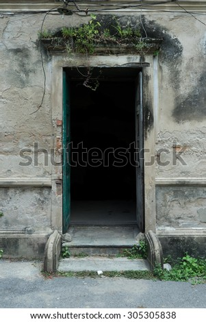 ancient door opening with dark shadow