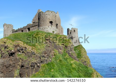 Ancient Dunluce castle , guardian of the coast. Northern Ireland - stock photo