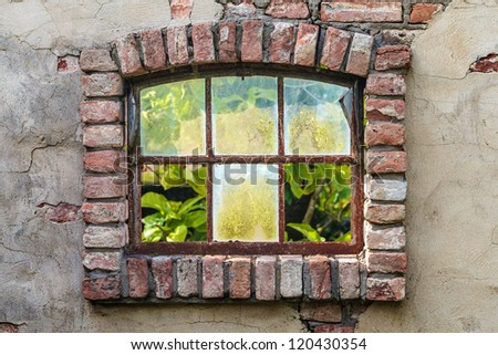Ancient Dutch farm window with broken glass - stock photo