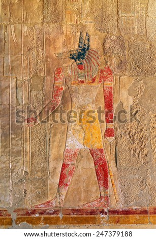 ancient egypt color image of anubis on wall in luxor - stock photo