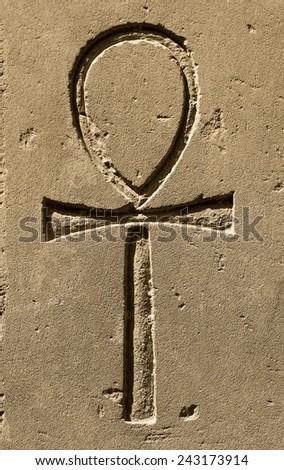 """Ancient egypt symbol Ankh (""""Key of Life"""", """"Eternal Life"""", """"Egyptian Cross"""") carved on the stone in the Karnak Temple, Luxor - stock photo"""