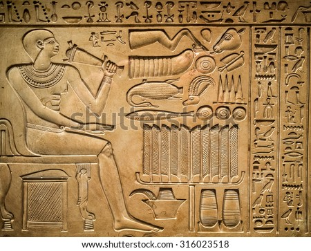 Ancient egyptian hieroglyph depicting a pharaoh, animals and signs - stock photo