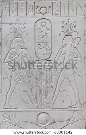 Ancient Egyptian hieroglyphics - replica on plaster wall - stock photo