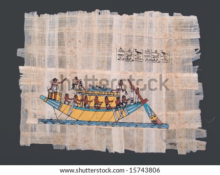 ancient egyptian papyrus with painting of nile boat and hieroglyphs - stock photo