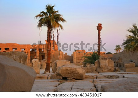 Ancient Egyptian ruins  in the temple of Karnak in Luxor Egypt, Africa at sunset