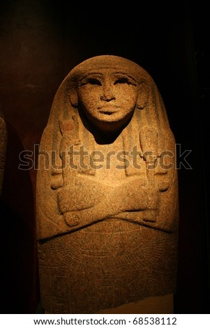 Ancient Egyptian sculpture in the dark background - stock photo