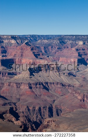 Ancient eroded sandstone in layers of color at the Grand Canyon National Park in Arizona. - stock photo