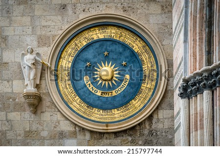 Ancient eternal cathedral calendar and clock in Messina. Sicily - stock photo