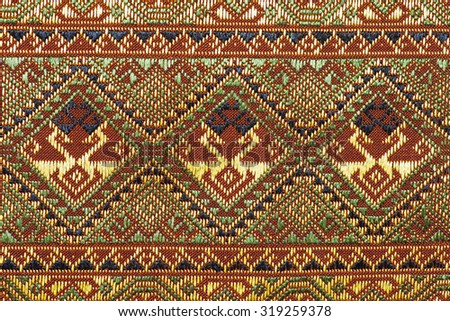 Ancient fabric more than 60 years old colorful thai silk handcraft peruvian style rug surface close up textiles peruvian beautiful background tapestry persian detail pattern farabic fashionable old - stock photo