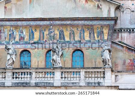 Ancient  facade of Santa Maria in Trastevere church in Rome - stock photo