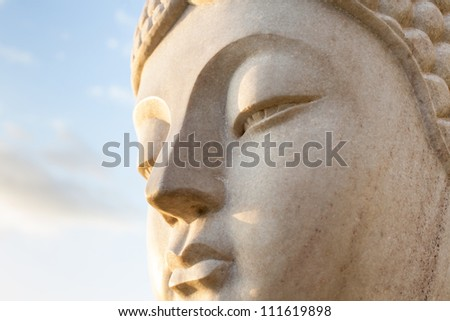 Ancient Face of a stone statue of Buddha - stock photo