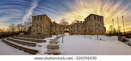 Ancient fortress at sunset. Panoramic view of the ancient fortress Tzari Mali Grad near Belchin, Bulgaria  - stock photo