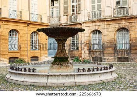 Ancient fountain in Aix en Provence town, South France - stock photo