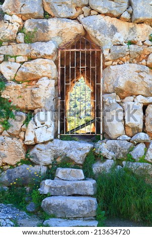 Ancient gate in the walls of Mycenae city, one of the major centers of Greek civilization, Peloponnese, Greece - stock photo