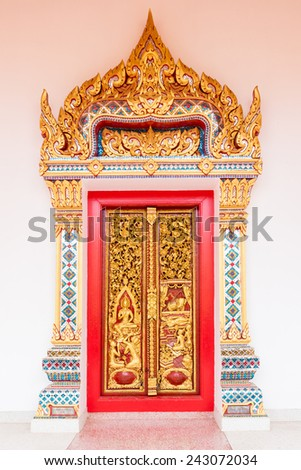 Ancient Gold carving wooden door of Thai temple - stock photo