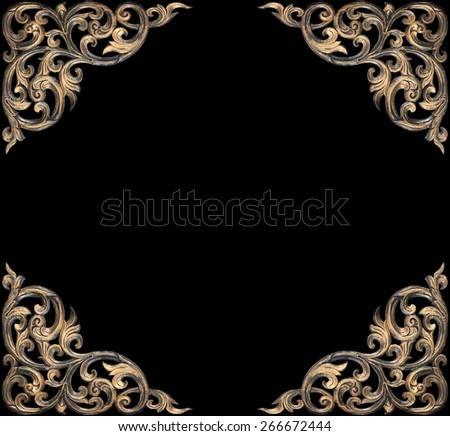 Ancient golden carving wooden decorative of Thailand temple isolated on black - stock photo