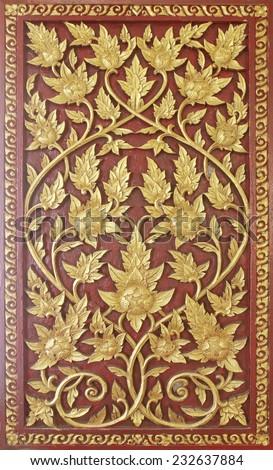 Ancient golden carving wooden door of Thai temple. Thailand - stock photo