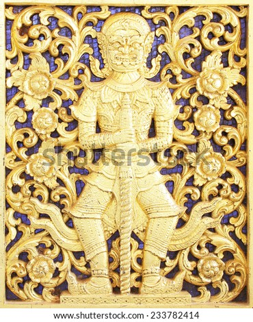 Ancient golden carving wooden window of Thai temple ; Vintage Thai style wood craft - stock photo