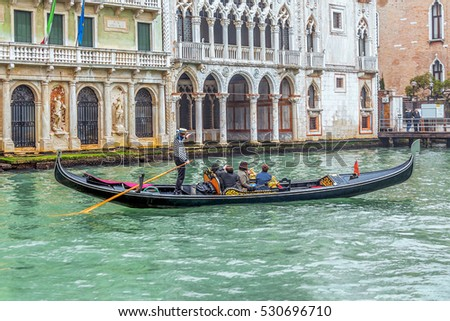 Ancient gondola is the main means of transportation of tourists in Venice on a sunny day - Italy