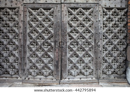 Ancient Gothic wooden double doors to St. Mary's Church in Gdansk, Poland