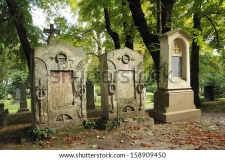 ancient graveyard tomb stones - stock photo
