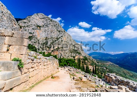 Ancient Greece. Ruins remains of the large temple of Apollo, Delphi, Greece, greek culture landmark. - stock photo