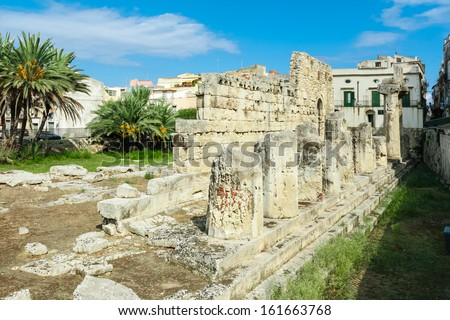ancient greek apollo temple ruins in Siracusa city Italy - stock photo