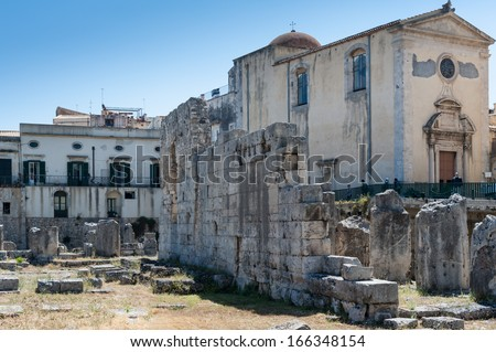 Ancient greek apollo temple ruins, tourist attraction in Siracusa, Sicily, Italy - stock photo