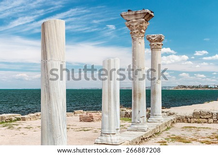 Ancient Greek basilica and marble columns in Chersonesus Taurica. Sevastopol, Crimea. Russia. Focus on the first column - stock photo