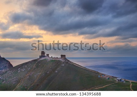 Ancient greek castle on the coast. Sunset above Balaklava bay.