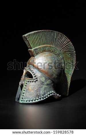 Ancient Greek Helmet Athenian Style in Low Key - stock photo