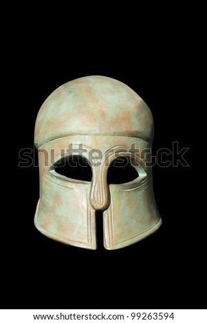 Ancient Greek Helmet over black background - stock photo